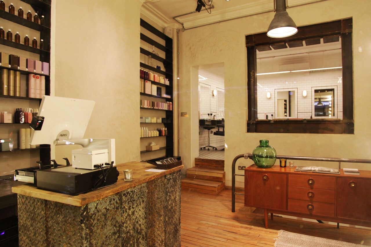 Reception area with organic hair products by O-Way at ESHK hairdresser in Clerkenwell on Gray's Inn Road, London