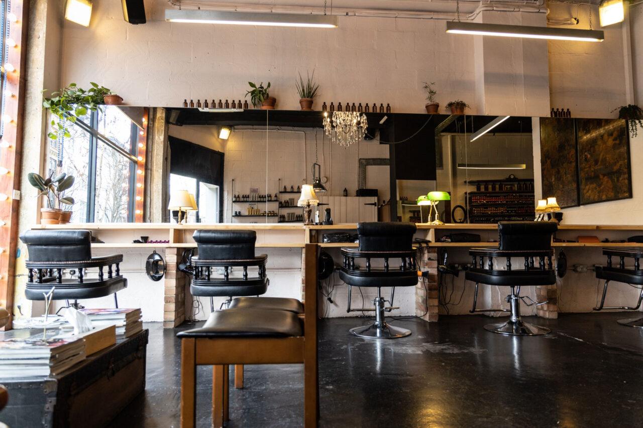 Hairdresser in Barbican and Farringdon salon interior at ESHK Hair Barbican