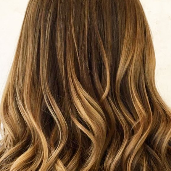 balayage in shoreditch waves and curls brown to blonde