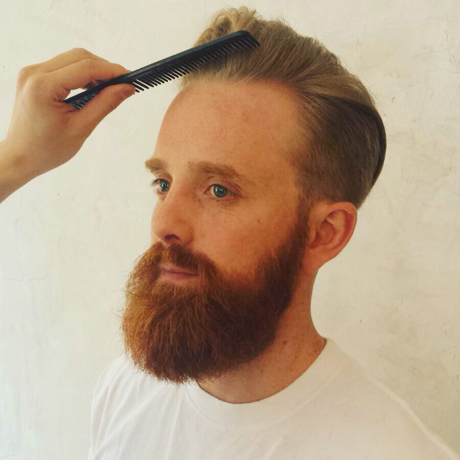 barber hairstyles beard and combed back haircut blonde