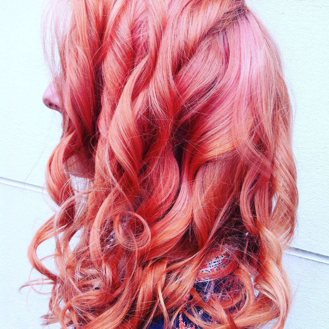 coral pink waves and curls hair colour in clerkenwell london
