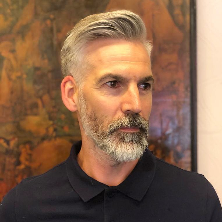 grey hair and beard barber style side brushed