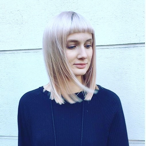 long blonde fringe cut colour protection treatment from wellaplex