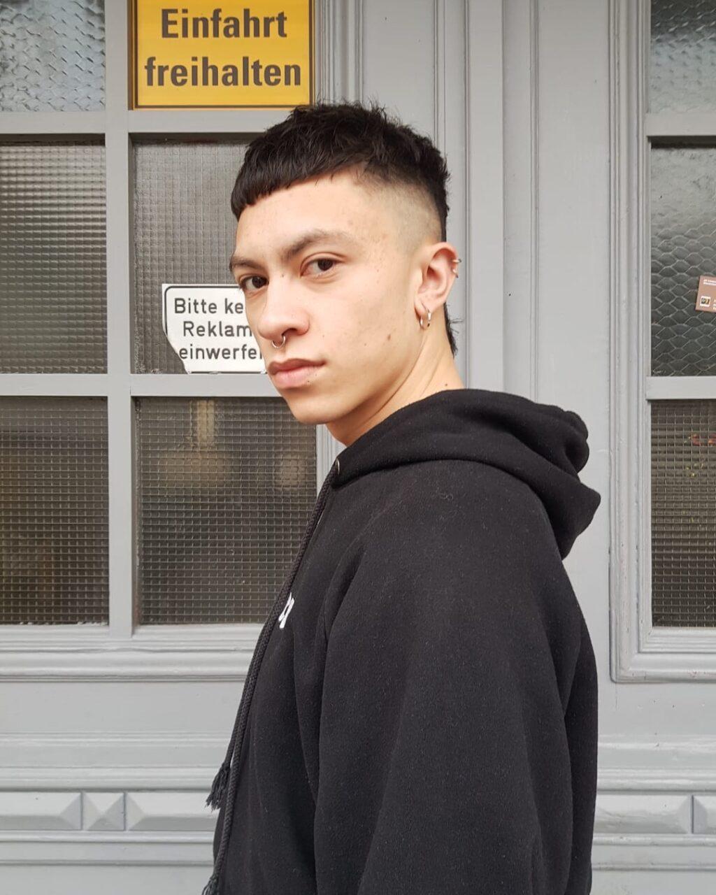 mullet short sides black hair berlin