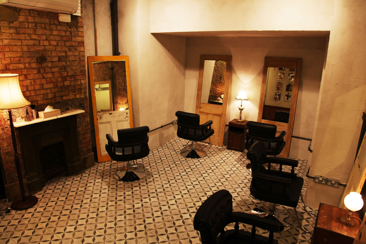 lower cutting room with reclaimed doors for the best balayage in Clerkenwell at ESHK hairdresser on Gray's Inn Road London
