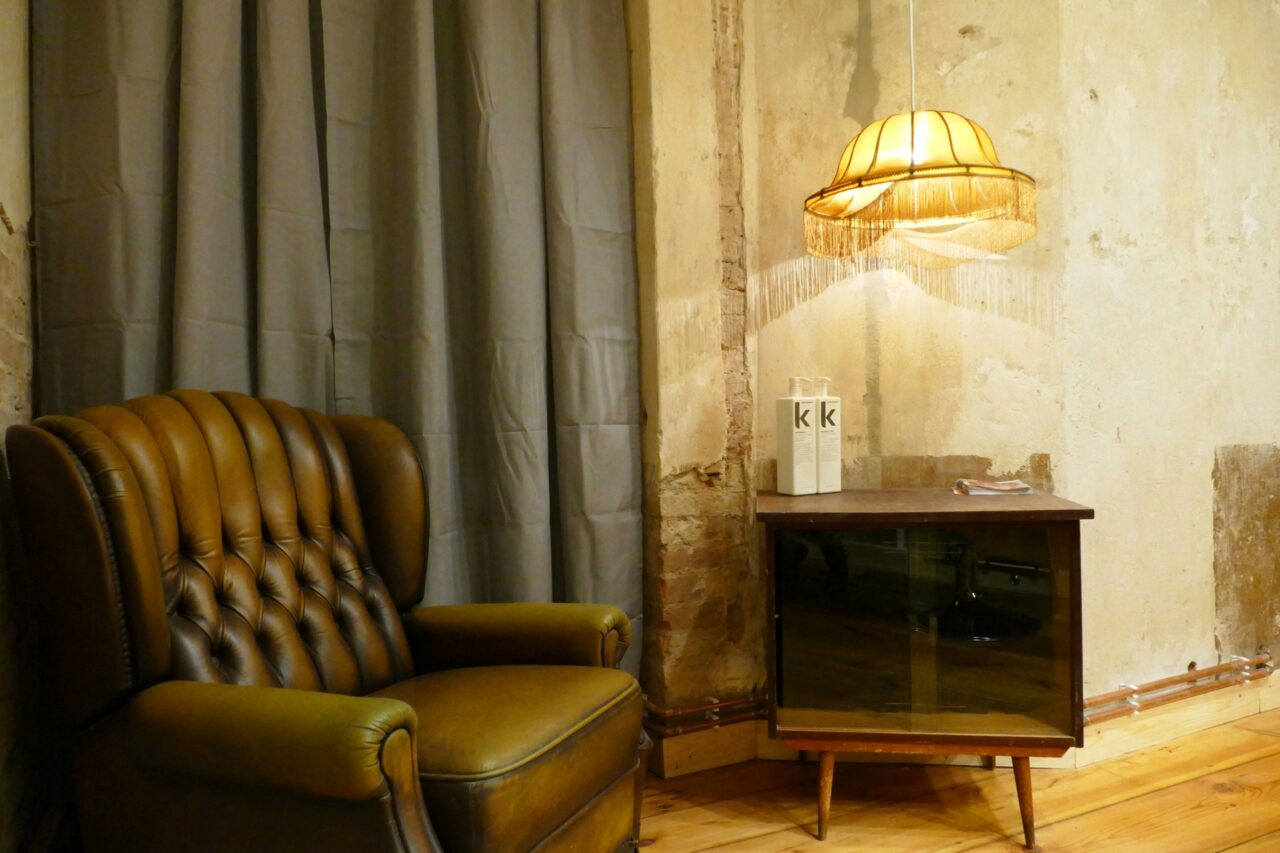 vintage couch, cabinet and light at hair salon design berlin